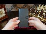 Фирменный чехол-книжка из качественной импортной кожи с мульти-подставкой застёжкой и визитницей для ХТС Дезайр 728 черный