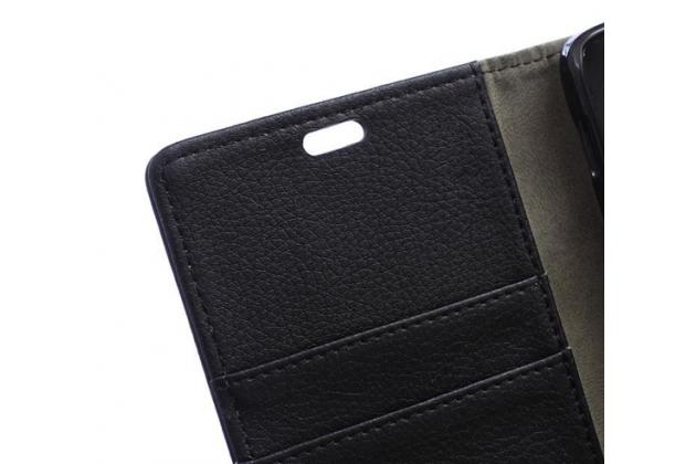 Фирменный чехол-книжка из качественной импортной кожи с мульти-подставкой застёжкой и визитницей для ХТС Дизаер 520 черный