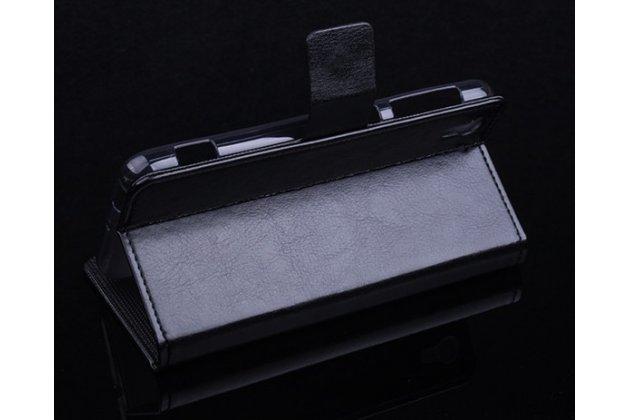 Фирменный чехол-книжка из качественной импортной кожи с подставкой застёжкой и визитницей для ХТС Дезайр Ай черный