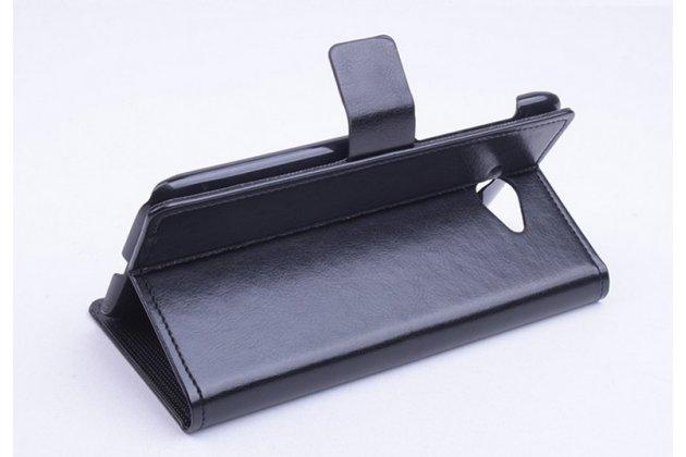 Фирменный чехол-книжка из качественной импортной кожи с подставкой застёжкой и визитницей для Леново Эс930 черный