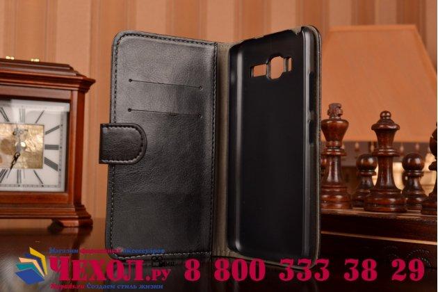 Фирменный чехол-книжка из качественной импортной кожи с подставкой застёжкой и визитницей для Леново А916 черный