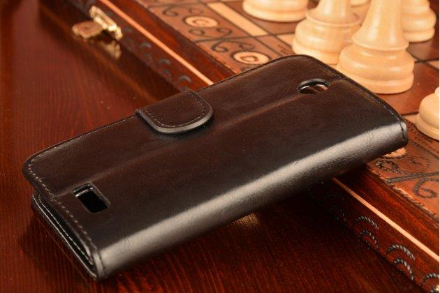 Фирменный чехол-книжка из качественной импортной кожи с подставкой застёжкой и визитницей для Леново А526 черный