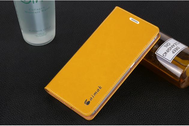 Фирменный чехол-книжка  из качественной импортной кожи с мультиподставкой для Nokia Lumia 1520 желтый