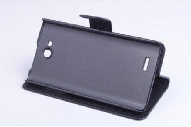 Фирменный чехол-книжка из качественной импортной кожи с мульти-подставкой застёжкой и визитницей для Филипс Ксениум Вэ6500  черный