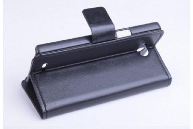 Фирменный чехол-книжка из качественной импортной кожи с мульти-подставкой застёжкой и визитницей для Филипс Ксениум Вэ3500  черный