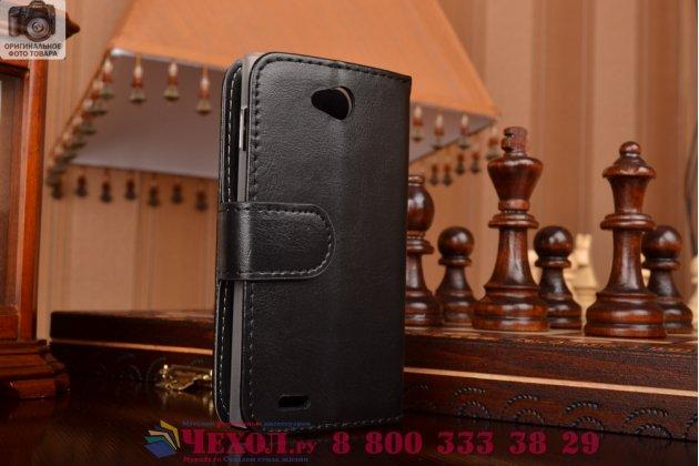 Фирменный чехол-книжка из качественной импортной кожи с мульти-подставкой застёжкой и визитницей для Филипс С301/С308 черный