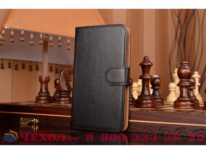 Фирменный чехол-книжка из кожи с мульти-подставкой застёжкой и визитницей для Philips Xenium V387 черный..
