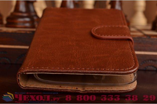 Фирменный чехол-книжка из качественной импортной кожи с мульти-подставкой застёжкой и визитницей для Филипс С388 коричневый