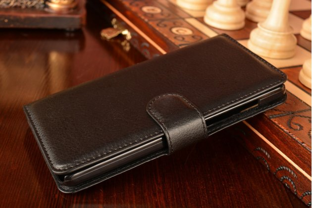 Фирменный чехол-книжка из качественной импортной кожи с мульти-подставкой застёжкой и визитницей для Ксиаоми Ми 4Це черный