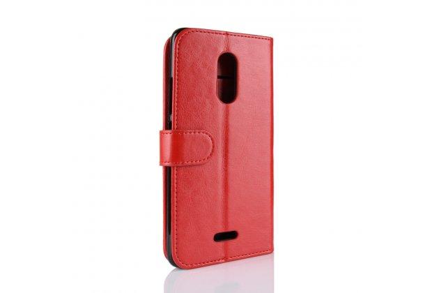 Фирменный чехол-книжка из качественной импортной кожи с подставкой застёжкой и визитницей для Alcatel 3C 5026D красный