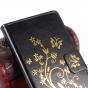 Фирменный чехол-книжка с рисунком на тему канделябры на Oukitel K10000 черный..