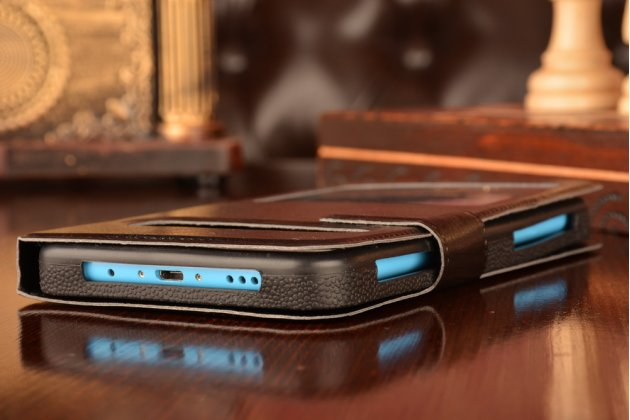 Чехол-футляр для HTC Wildfire S с двумя окошками для входящих вызовов и свайпом из импортной кожи с внутренним защитным силиконовым бампером. Цвет в ассортименте.